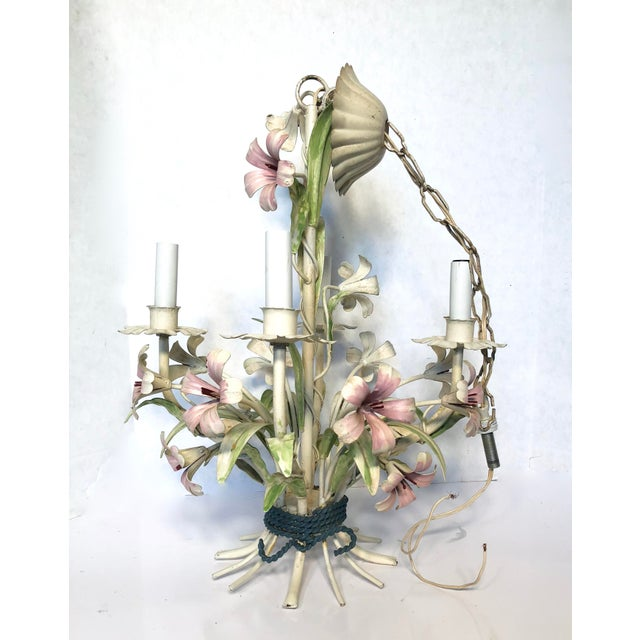 Beautiful vintage floral Italian tole chandelier. Features y with the pink flowers, and green leaves The chandelier has...