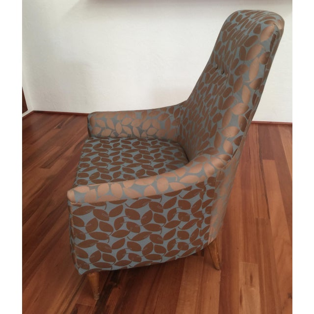 A vintage Mid Century Modern Chair reupholstered with new delicate silk leaf fabric. I can provide a fabric swatch upon...
