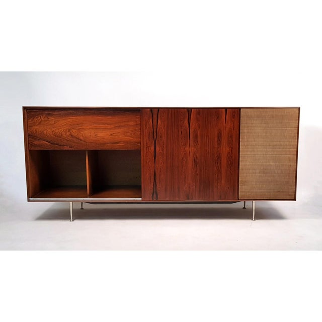 Rare Rosewood cabinet by George Nelson for Herman Miller with drop down panel that opens to reveal the original Garrard...