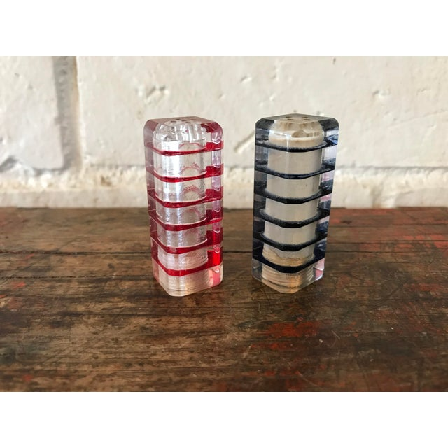 Vintage 50's Lucite stacked cube shaped tower salt and pepper shakers in red and black. Both in excellent condition.