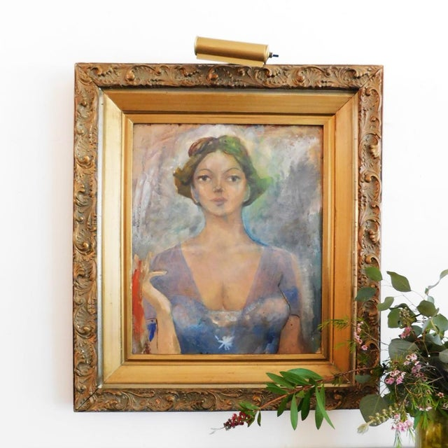 This beauty is mid century, acrylic on wood, framed in gold and adorned with a functional gallery light. We adore this...