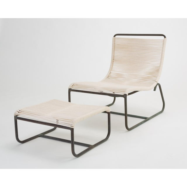 """A pair of low lounge chairs, known as the """"Sleigh Chair"""" by Walter Lamb for Brown Jordan. The pair comes with a single..."""