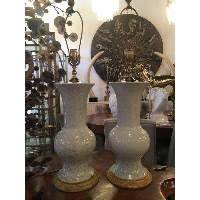 Pair of large vintage table lamps. Crackled glaze finish, brass pagoda top. These came from the Breakers of Palm Beach...