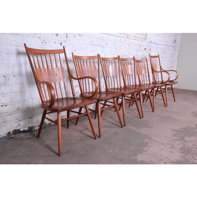 Offering a rare and gorgeous set of six mid-century modern sculpted walnut dining chairs designed by Kipp Stewart for his...