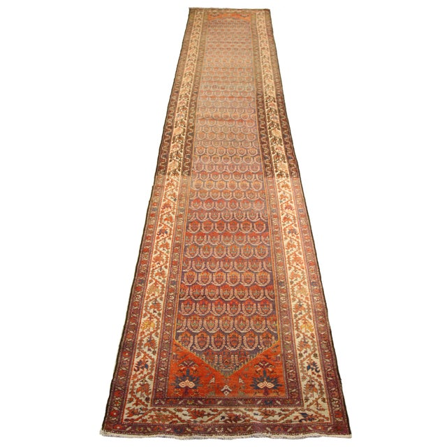 Made from the finest wool and natural vegetable dyes, this antique Persian rug features repeating patterns of traditional...