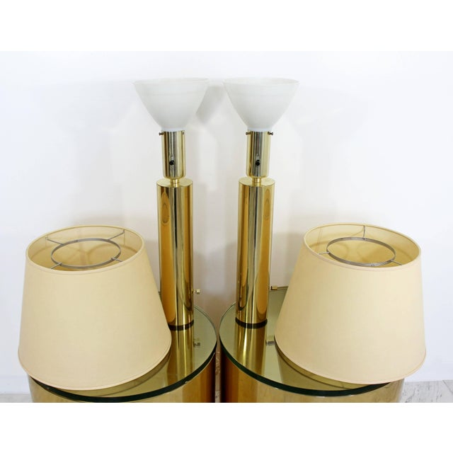 For your consideration is a fantastic pair of cylindrical brass, table lamps, in the style of Kovacs, circa the 1970s. In...