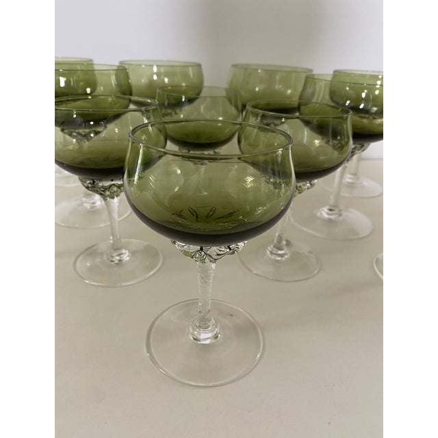 Six unusual leaf green coups or red wines with lovely applied twisted stems along with six smaller matching after dinners-...