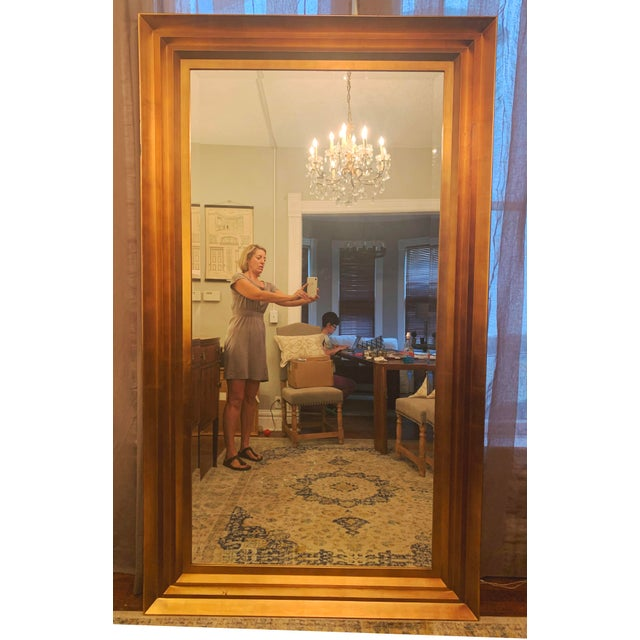 Gorgeous large art deco style floor mirror. Beveled glass and gold leaf frame. Very well made. This piece was acquitted...