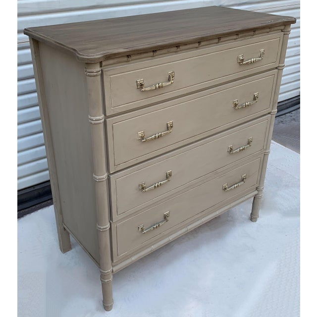 This is a mid-century faux bamboo tall chest that has been given a fresh update in a hand painted distressed finish. It is...