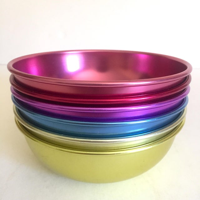 This set of six vintage Mid Century Modern anodized spun aluminum multicolor snack dessert bowls are a very special and...
