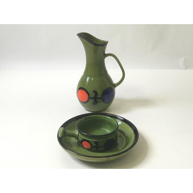 Vintage modern hand painted serving pitcher with dip bowl & plate. Olive green with black trim and bold red/orange & blue...