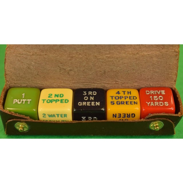 This is a vintage Abercrombie & Fitch dice set that includes 5 die. The set is from the 1950s.