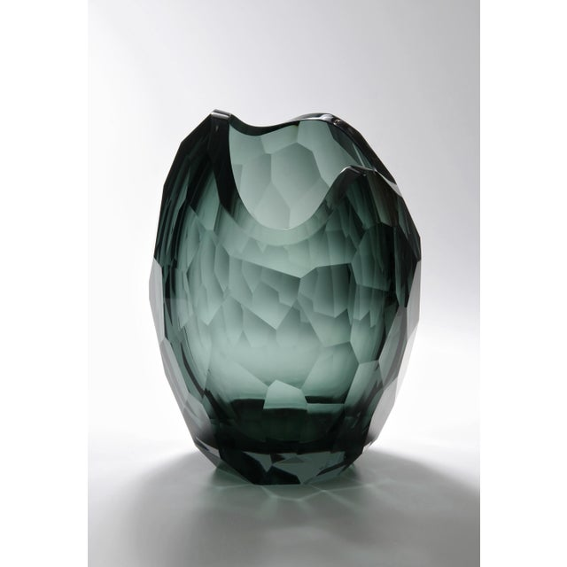 The Glacier Vase was designed by David Wiseman, a star in the design world. Its slightly asymmetrical shape evokes natural...