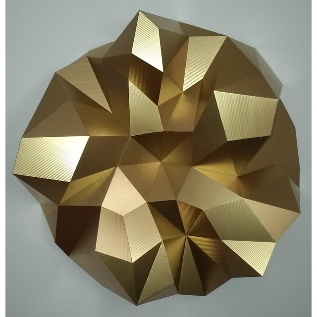 Beautiful gold wall hanging sculpture, light-weight and hangs like a painting. This sculpture is a part of a series of 3...