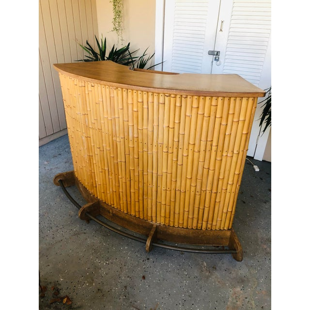 Sophisticated 1940s bamboo or rattan tiki bar expertly crafted with an Quarter-sawn oak top and base with a brass...