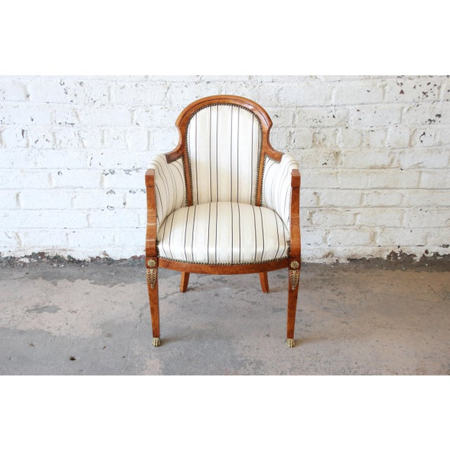 Offering a very nice antique Biedermeier style armchair. The chair features a nice pinned stripped ivory studded...