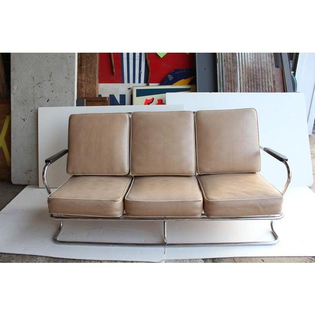 1940's Art Deco American Tubular chrome three-seat sofa in the style of Kem Weber.