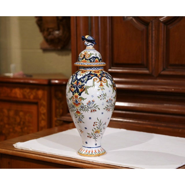 This elegant antique vase was crafted in Normandy, circa 1880. The ceramic, rounded potiche features hand-painted flower...