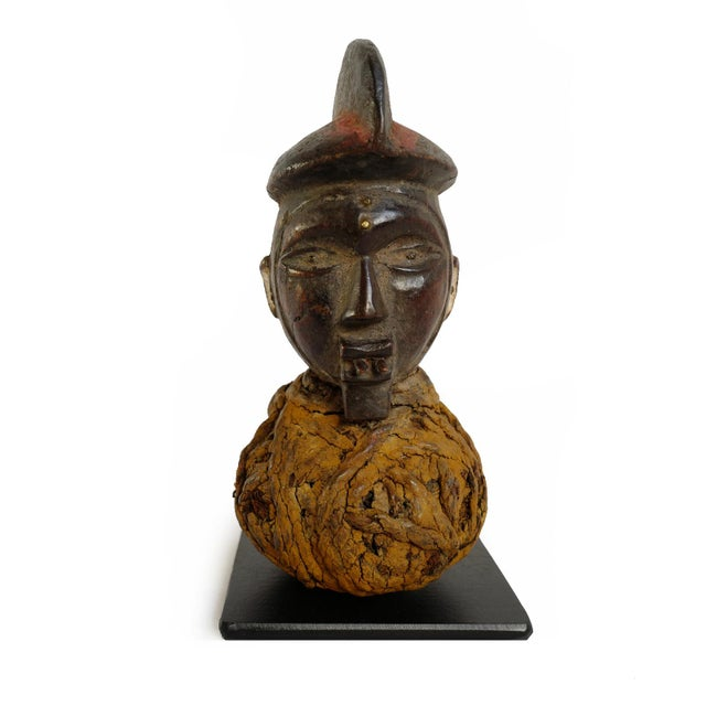 Yaka Mbwoolo wood fetish head with ceremonial pouch from the Wamba river region of DRC. Originally used placed on a shrine...