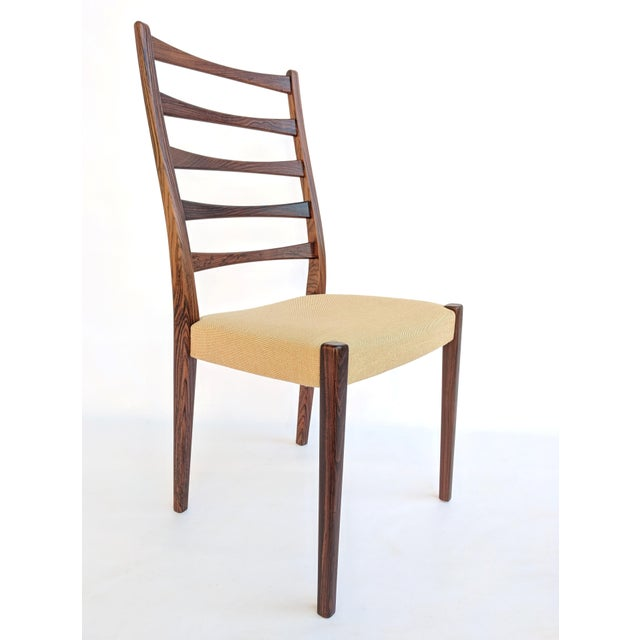 Set of four 1960s rosewood ladder back dining chairs by Svegards Markaryd, Sweden. In excellent condition, the chairs have...