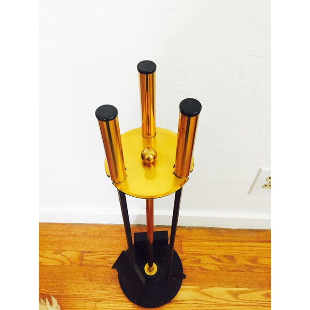 A mid century modern set of fireplace tools designed in the style of George Nelson. Each tools features a brass handle and...