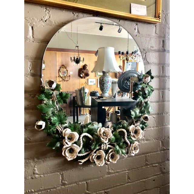 Wonderful Vintage 1940s Hollywood Regency Round Tole Wall Mirror. The tole floral decor surrounds the bottom and lower...