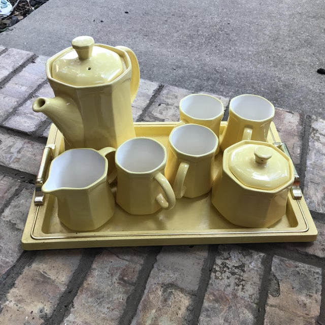 Made in Japan ceramic tea-time serving tray with tea pot, four mugs, sugar & creamer. Mid-Century Modern cool yellow color.