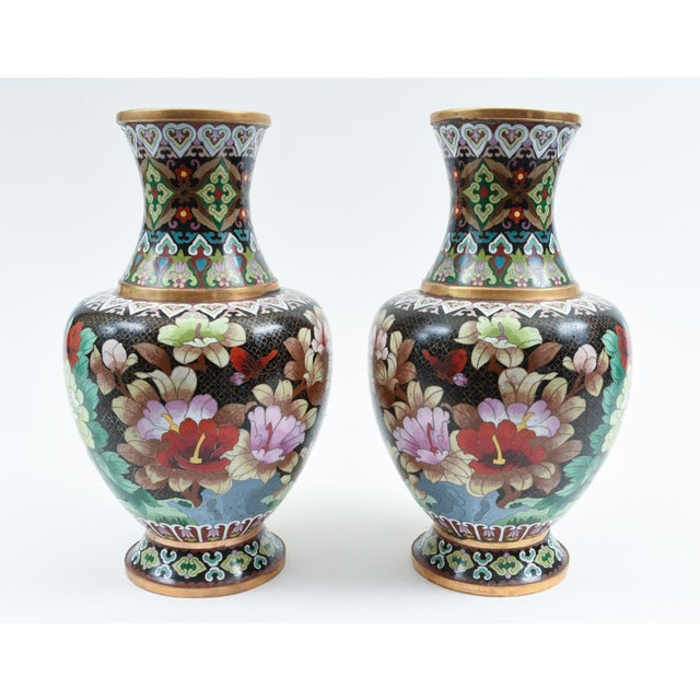 Mid-20th century pair of colorful cloisonné pieces / vases with blossom flowers and birds design details. Each vase /...