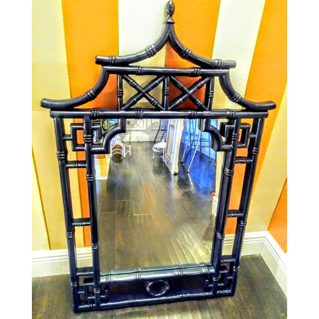 Stunning pagoda shaped wall mirror custom painted in a beautiful deep gloss navy blue color. The mirror is in great...