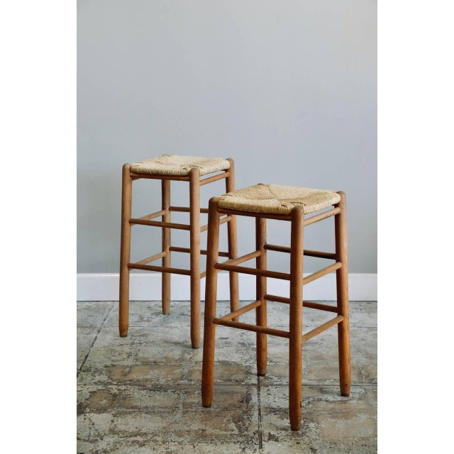 Pair of rush bar stools in the style of Charlotte Perriand.