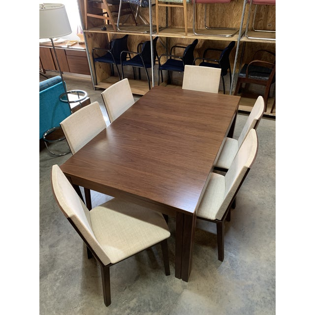 In stock and ready to deliver before the holidays! A beautiful Danish Modern dining table and set of six chairs by Skovby...