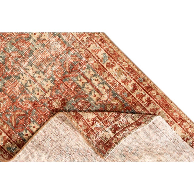 A hand-knotted antique Persian rug with a floral design. This piece has great detailing and colors. It would be the...