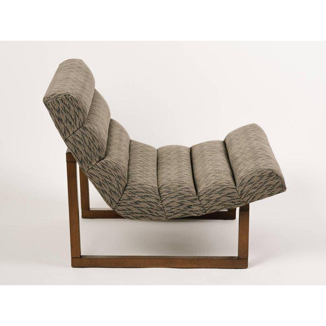 Mid-Century Modern slipper chairs with floating scoop seats and streamline walnut wood frames. Great looking from all...