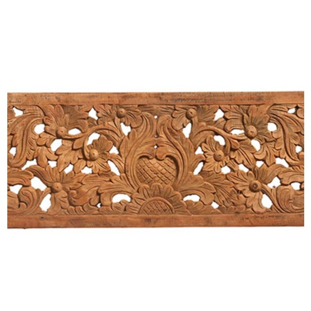 Beautiful hand carved panel with intricate floral design made from old teak wood. Stunning decorative piece to add...