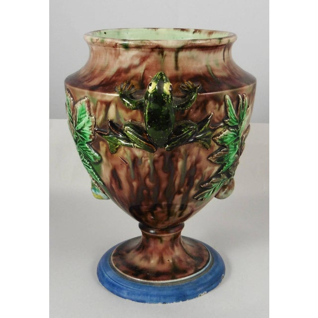 A 19th century Palissy vase with two frogs for handles, they are decorated with leaves and snails signed Thomas Sergent....