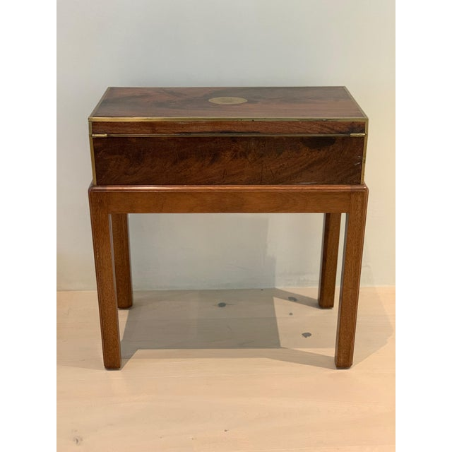Antique (19th century), burled walnut box on separate (newly) custom made, mahogany stand . Top of box has a brass, oval...