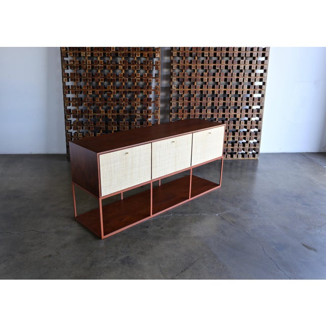 Milo Baughman for Murray furniture walnut cabinet with enamel and steel, circa 1954. This piece has been professionally...