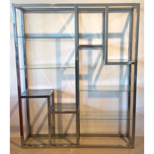 Vintage Milo Baughman Style chrome and glass display shelf étagère. There are ten glass shelves. Chrome will be polished...
