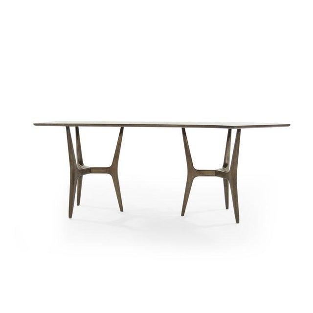 A fantastic walnut desk with an asymmetric form, circa 1950s. Fully restored.