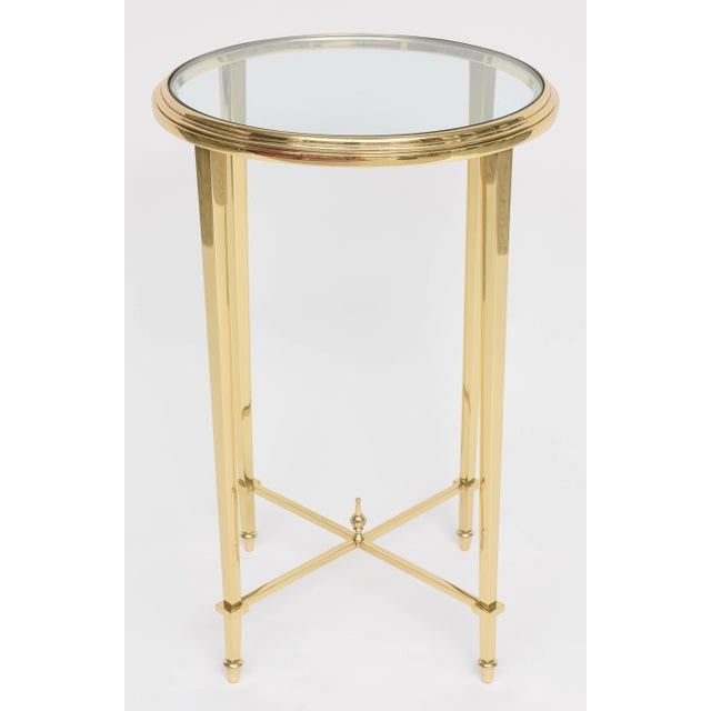 This stylish and chic brass and glass side table is inspired by the iconic firm of Maison Jansen. They are cast in solid...