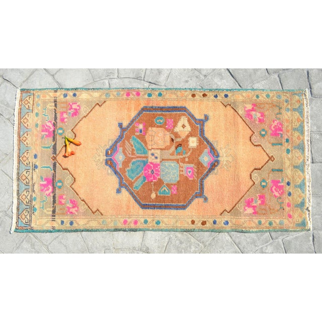 A vintage Turkish small yastik rug, beaver (strong orange) background color yastik rug perfect for entryway, bath or in...