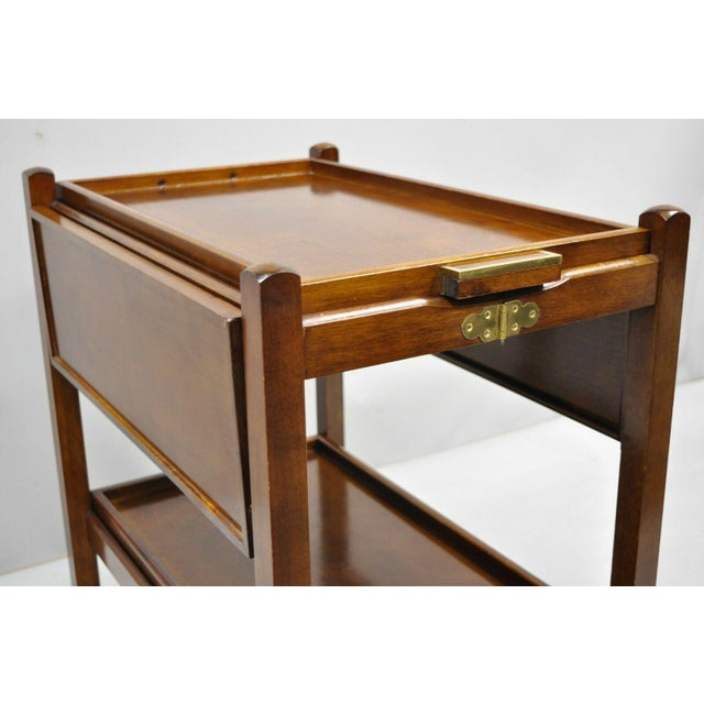The Bombay Company Modern Rolling Folding Bar Tea Cart Server. Item features 2 removable trays, drop leaf slides, rolling...