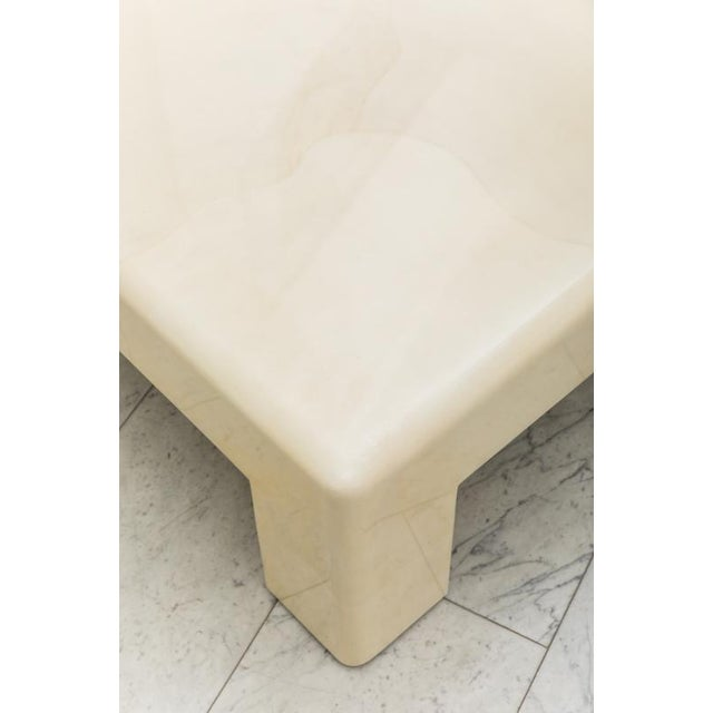 A low table made with the free form inlay of natural goatskin with a polished lacquered finish. Springer's elegant form is...