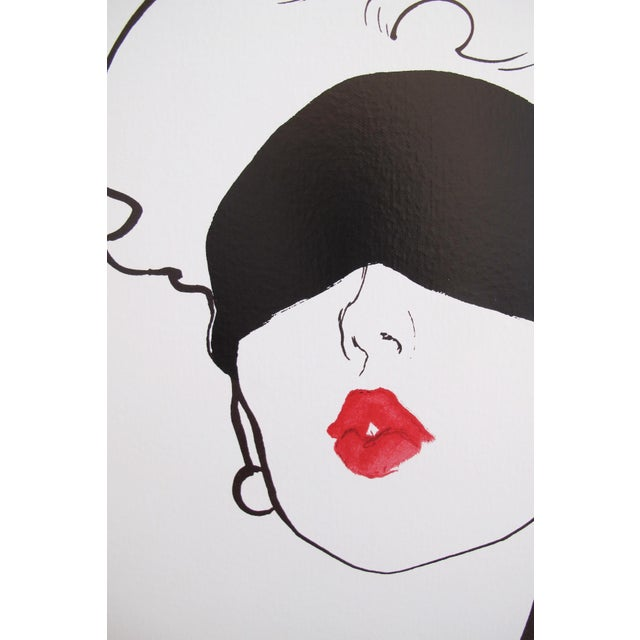 """René Gruau's image of the blindfolded, pouting """"Rouge Baiser"""" (Fr: Red Kiss) woman was created in the 1940s for the French..."""