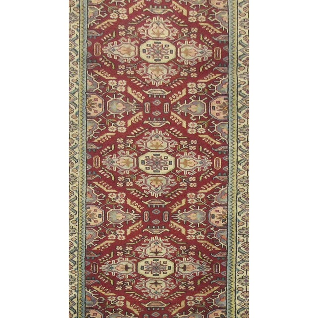This beautiful rug is hand made, made in Iran. It features a pattern in a vibrant combination of red, blue, white. With...