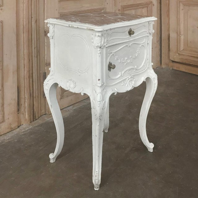 19th Century French Louis XV Painted Nightstand represents the essence of the style with curvaceous legs and finely...