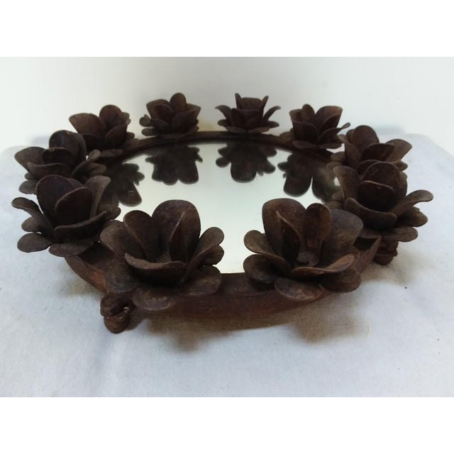 Great looking rusted iron mirror topped plateau with ball feet and flower design that can be used to hold candles.