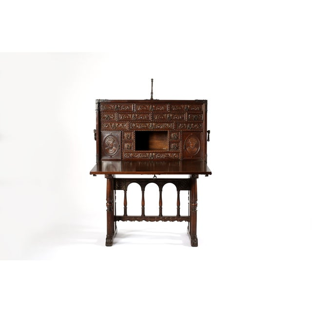 Exquisite 18th century Spanish vargueño / cabinet desk / chest on stand featuring dramatic hand carved design details ....