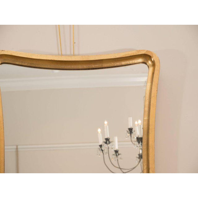 """A fantastic pair of giltwood """"wavy"""" mirrors from Italy. The frames have a depth to them that make them appear sculptural...."""