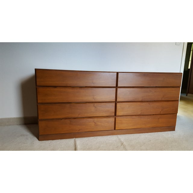 From the Dixie Scova line, this Mid-Centuy Modern dresser with Danish influence has simple lines with flush drawer design...